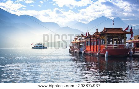 Boat And Speed Boat Pier In Sunrise Morning At Sun Moon Lake , Taiwan