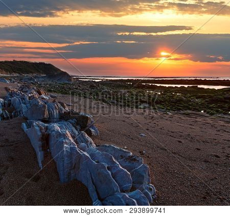 Sunset Ocean Coast View From Beach With Big Picturesque Stones (near Saint-jean-de-luz, France, Bay