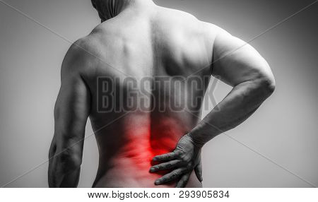 Muscle Man With Pain In His Back. Red Color Zone Is The Pain. Medical Concept On Gray Background
