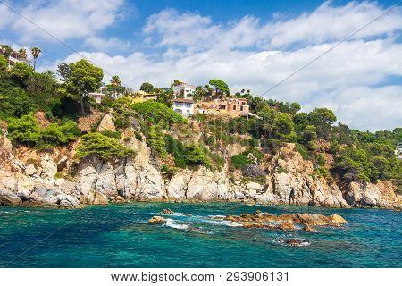 Beautiful Villa On High Rock On Sea Shore Of Spanish Coast In Costa Brava, Spain. Sea Landscape Of R