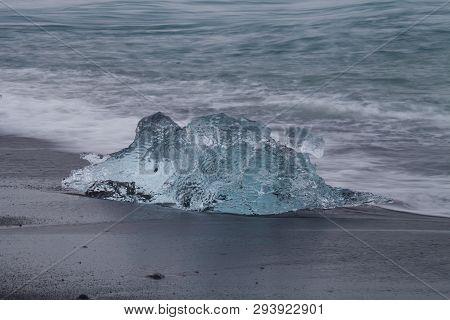 Amazing Transparent Blue Iceberg Pieces On Diamond Beach With Black Sand Near Jokulsarlon Lagoon, Ic