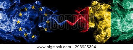 European Union Vs Guinea, Guinean Smoke Flags Placed Side By Side. Thick Colored Silky Smoke Flags O