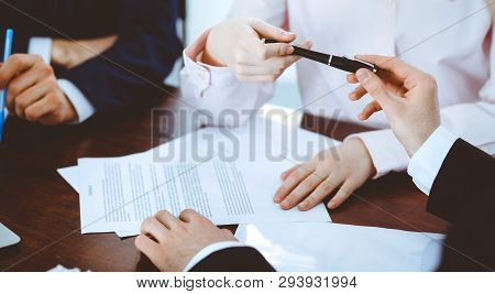 Business Women Giving A Pen To Businessman For Contract Signing. Agreement At Negotiation Or Meeting