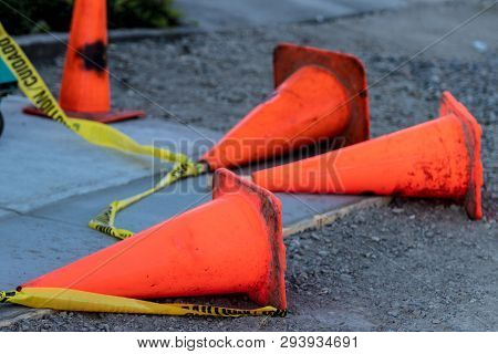 Fallen Orange Traffic Cones And Caution Tape In Daylight