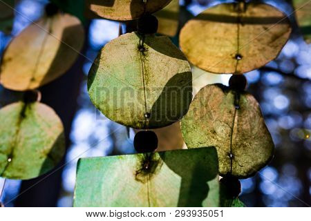 Abstract Dirty Glass Wind Chimes With Sunlight Glowing