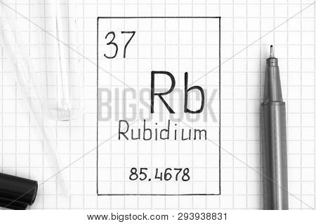 The Periodic table of elements. Handwriting chemical element Rubidium Rb with black pen, test tube and pipette. Close-up. poster