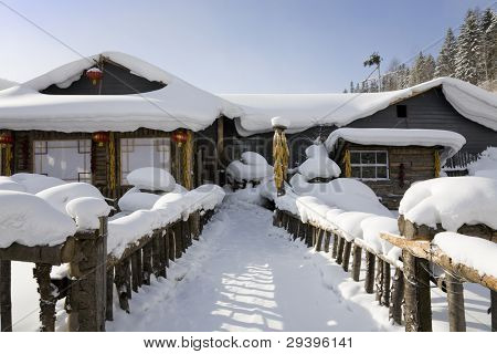 snow-covered wooden house. ( The Chinese characters on the red lanterns means