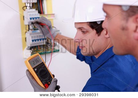 Two technical engineers checking electrical equipment
