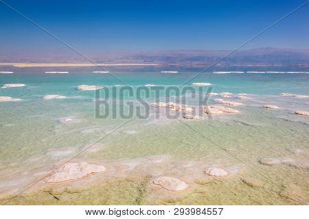 Stunning Blues And Stark White Salt Piles Dotting The Dead Sea