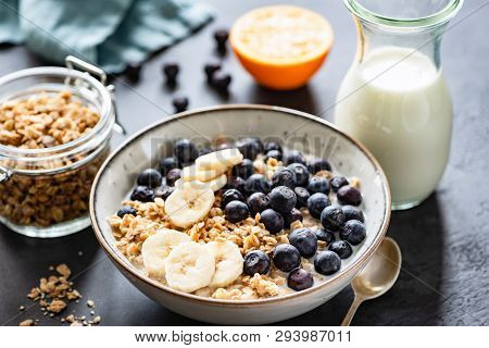 Granola, Fruits, Berries In Bowl On Black Concrete Background. Healthy Breakfast Cereals. Concept Of