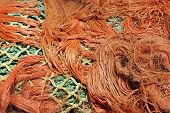 Multi-coloured fishing net in a tangle. Horizontal. poster