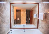 Hygienic Modern Luxury Bathroom Facility Design background. Hotel Resort Accommodation Interior Architecture, Decoration concept for toilet, washbasin, sink, lavatory, privy, and water closet poster
