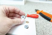 Hand holding fitting, fixing or fastener for mounting assembling furniture made of chipboard poster