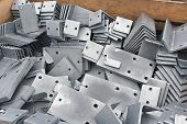 Metal parts for mounting structures with a galvanized coating. Metalworking with electroplating protects the metal from corrosion. poster