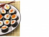Sushi rolls on a white plate on a white background poster