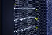 Close up view grid door of modern mainframe in high tech internet data center abstract . Server hardware, networking, technology concept with Depth of field, selective focus poster