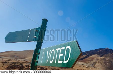 Crossroad Signpost Saying This Way, That Way, Voted