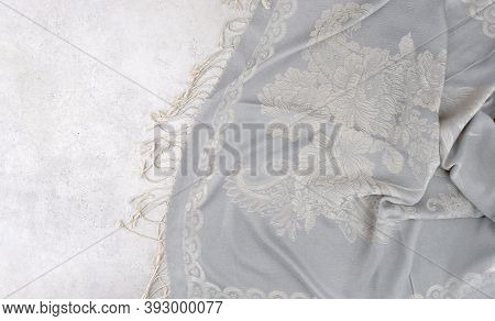 Blue Cloth With Ornament On Cement Background. Surface Of Stone Tile And Painted Shawl Fabric, Top V