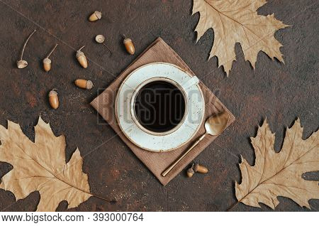 Acorn Coffee With Autumn Leaves On A Brown Background. Cozy Fall Still Life. View From Above. The Co