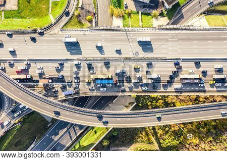 Aerial Drone View Of Road Interchange Or Highway Intersection With Busy Urban Traffic In Modern City