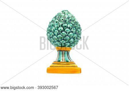 Green Pine Cone In Sicilian Ceramic.green Pinecone In Sicilian Ceramic From Caltagirone Isolated On