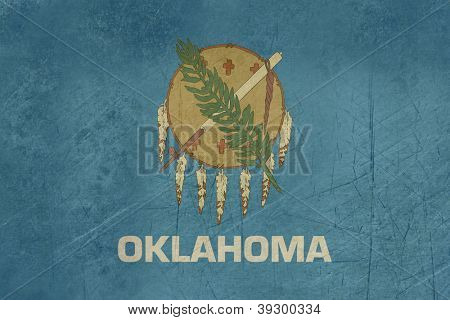 Grunge Oklahoma state flagga Amerika, isolerad på vit bakgrund.