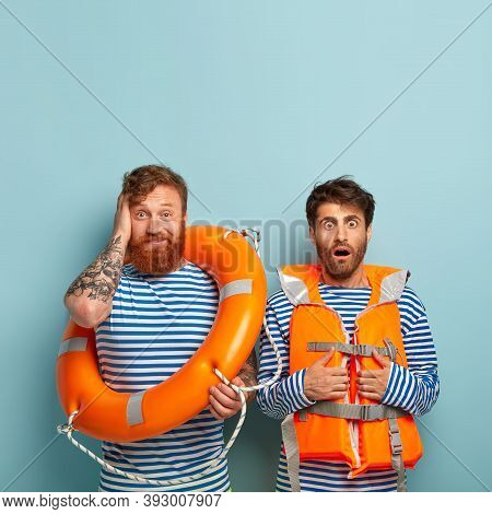 Horrified Male Insructor In Lifejacket And His Trainee, Wears Sailor Clothes, Have Swimming Lessons