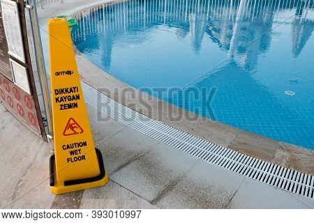 Belek, Turkey - October 2020: Safety Measures At A Luxury Hotel. Warning Sign About Wet Floor Near A
