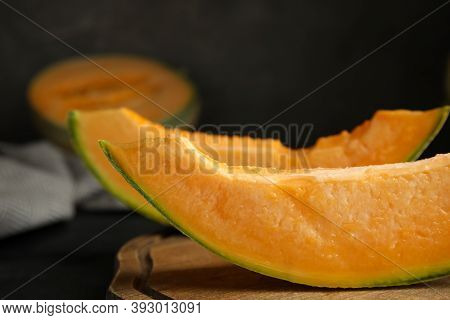 Slices Of Tasty Fresh Melon On Wooden Board, Closeup