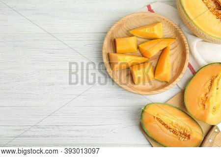Tasty Fresh Cut Melons On White Wooden Table, Flat Lay. Space For Text