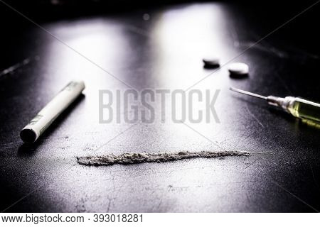 Row Or Row Of Cocaine, Illegal Drugs In A Dark Setting,
