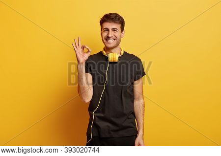 Happy Caucasian Guy Shows Okay Gesture, Agrees With Something, Asserts Everything Is Fine, Smiles Br