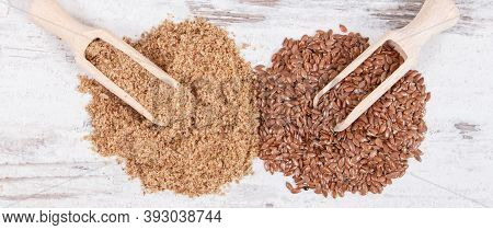 Linseed On Old Rustic Board. Healthy Food Containing Natural Vitamins, Dietary Fiber And Acids Omega
