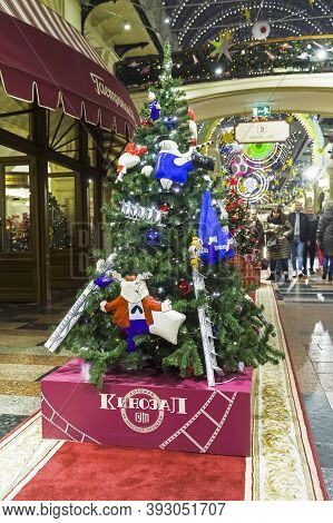 Moscow, Russia - December 15, 2019: Christmas Trees With Symbols Of Various Companies In Gum. Christ