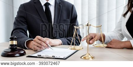 A Male Lawyer Or A Judge Counseling Clients About Judicial Justice And Prosecution With Scales, Judg