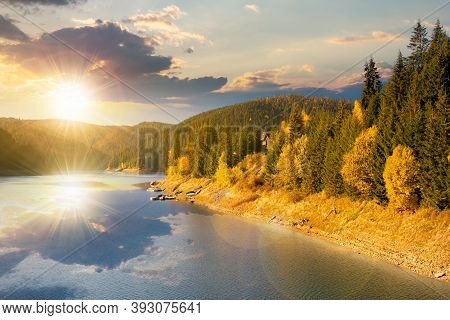 Mountain Lake In Autumn Season At Sunset. Beautiful Countryside Scenery In Evening Light. Blue Sky W
