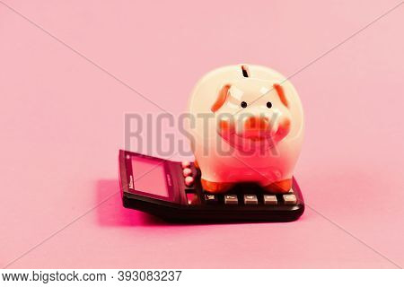 Bookkeeping. Financial Problem. Money Saving. Accounting And Payroll. Moneybox With Calculator. Pigg