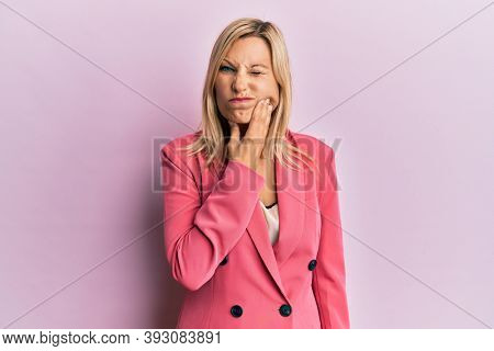 Middle age caucasian woman wearing business jacket touching mouth with hand with painful expression because of toothache or dental illness on teeth. dentist