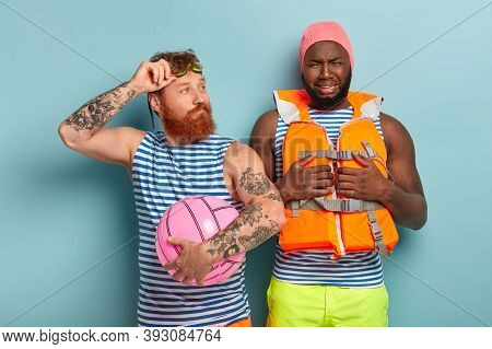 Dissatisfied Afro Man Being In Low Spirit, Wears Swimcap And Lifejacket, Doesnt Want To Swim, Male C