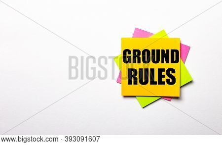 On A Light Background - Bright Multicolored Stickers With The Text Ground Rules. Copy Space