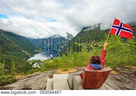 Travel Adventure Concept. Female Tourist Enjoying View Over Geirangerfjord From Flydalsjuvet Viewpoi
