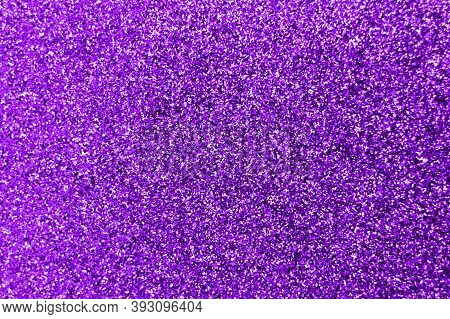 Glitter Splash And Lens Flare On Purple Shiny Trendy Background. Sequins. Festive Background For You