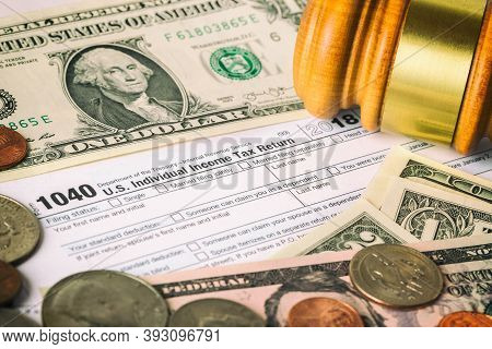 Closeup Image Of American 1040 Individual Income Tax Return Form With American Dollar Money, Coins A