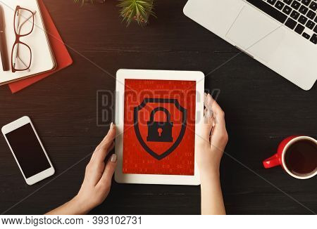 Digital Security And Online Business. Business Woman Works On Tablet With Red Screen And Blocked Web
