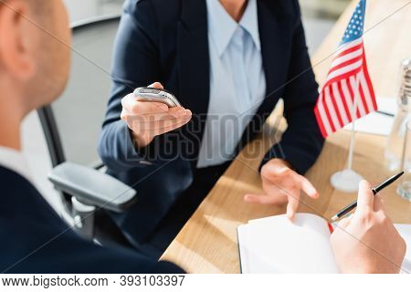 Partial View Of Journalist With Dictaphone Interviewing Politician During Press Conference On Blurre