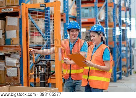 Warehouse Man And Woman Or Factory Worker Discuss Together With Happiness Emotion And Stand With Han