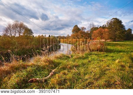 Colorful Autumn Landscape With Forest, Field, Lake. Scenic Rural Landscape