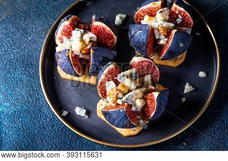 Appetizer With Figs And Blue Cheese. Salted Cracker. Cheese With Honey. Snack And Antipasto. Dorblu