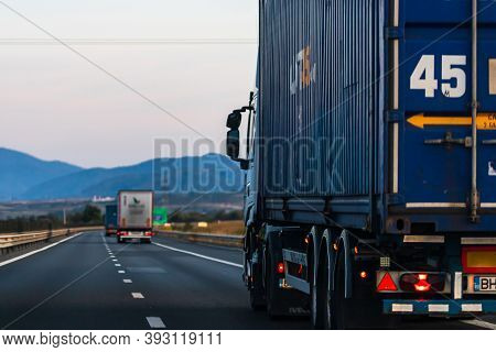 Side View Of Loaded European Truck In Motion On Asphalt Road, Transportation And Delivery Concept. D