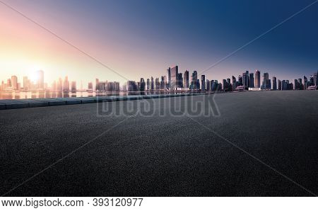 Panoramic Skyline And Buildings With Empty Space Dark Paved Road. Sunrise Over The City View. City U